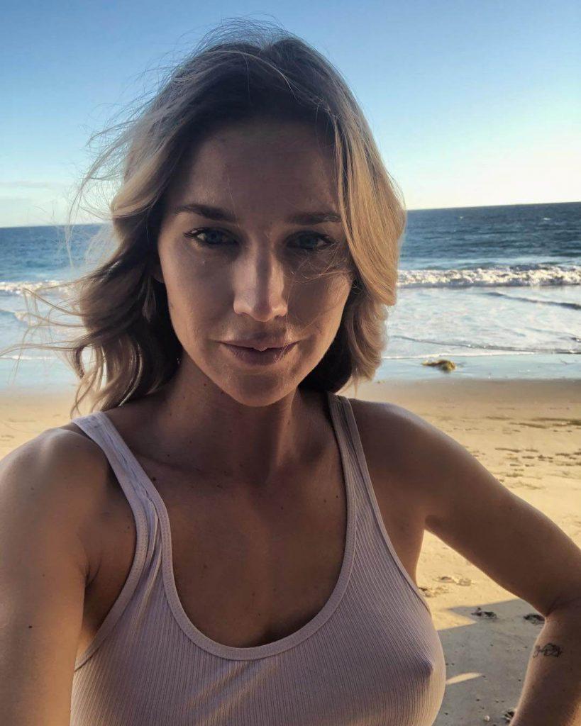 Ex-tennis star Ashley Harkleroad goes Naked again in